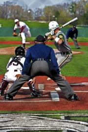 Ann Arbor Gabriel Richard batter rocks back to slap a hanging curve by Ann Arbor Pioneer Pitcher.